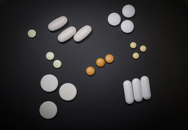 Different medications in a variety of shapes, colors, and sizes.