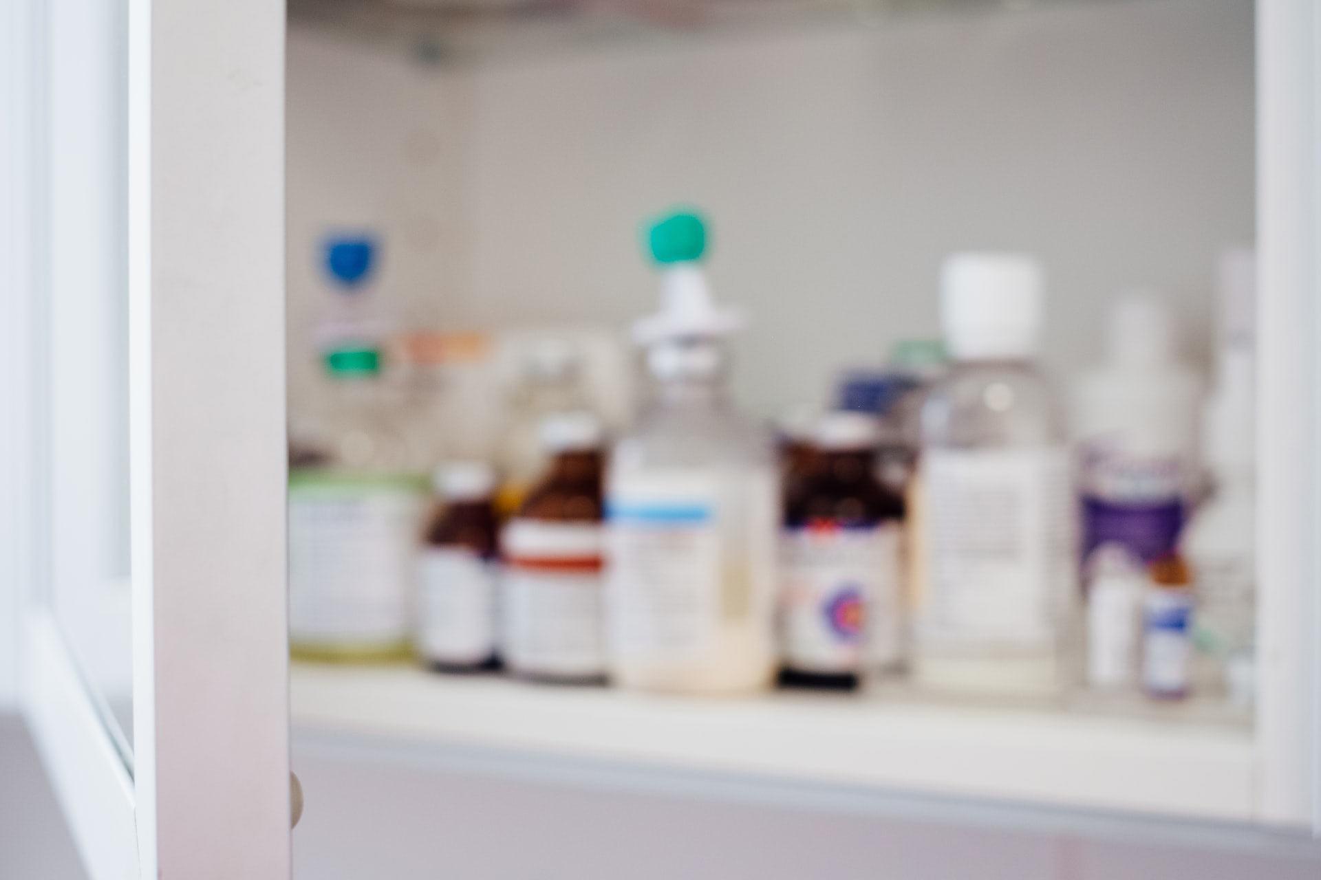 A blurry shot of someone's prescriptions in a medicine cabinet
